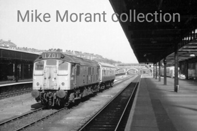BR Sulzer Type 2 Bo-Bo diesel electric no. 25063 in charge of a BR Mk 1 inspection saloon on the relief road at Exeter Central station in 1975. [Mike Morant collection]
