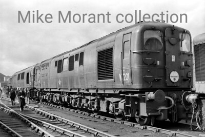 Classified as class D16/2 by BR, the diesel electric locomotive nearest the camera is Bulleid 1-Co-Co-1 no. 10201 whilst behind it is no. 10203. This shot was taken at the Derby Works open day in August 1962 by which time these two members of this class had been withdrawn although 10202 was still active but would be withdrawn at 1A Willesden mpd in December 1963 to join her siblings in store at Derby where they would all remain, amazingly, until February 1968 when they were reduced to scrap metal by Cashmore's. [Mike Morant collection]