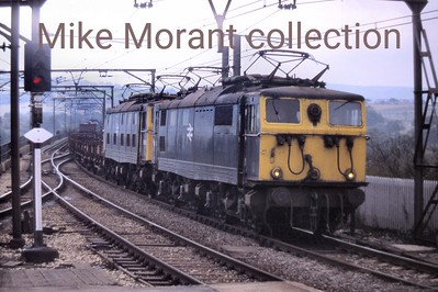 A pair of Woodhead route EM1 Bo-Bo electric locos 76007 and 76008 in BR corportate blue livery . The slide is dated 1978 and the stated location is Dinting.