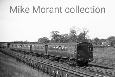 A pair of ex-LNWR Oerlikon 3-car electric units speeds southwards next to the WCML through Hatch End  en route from Watford to Euston in 1938.