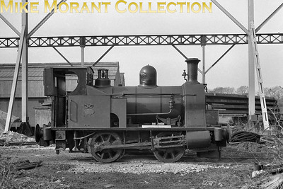 """With the motion protected by a generous layer of grease, Kerr Stuart built 0-4-0WT (works number 3063 of 1918) is photographed at Fairfield-Mabey engineering works, Chepstow in March 1965. It had spent its working life in the area, being supplied new to the Admiralty for the Beachley Shipyard line (River Severn naval docks). [A.E. """"Dusty"""" Durrant / Mike Morant collection]"""