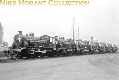 "These seven new locos are IGR (Indian Government Railways) 5' 6"" gauge HPS class 4-6-0's built by Vulcan at Newton-le-Willows and formed part of a works order for 84 to be built in 1949/50 and were a repeat of earlier orders just after the war. The leading loco has the number plate 7773 on its cabside which must be its IGR number as the works numbers for this series were in the range 5750 thru' 5833. One suspects that this shot was taken at Birhenhead Docks prior to shipment to India."