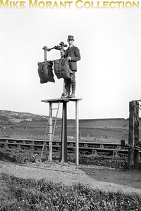 GPO mail exchange apparatus circa 1920's. There's no supporting data for this shot but perhaps viewers could contribute. The apparatus is next to what seems to be a single track main line. The photographer is known (from other negatives that he took and are in my collection) to have visited Scotland, mid-Wales, north Wales and Cornwall. Does a viewer recognise the backdrop? [E. A. Gurney-Smith / Mike Morant collection]