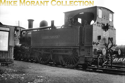 London Transport at its most rural: ex-Metropolitan Railway 'A' class 4-4-0T No 23 at Brill. Although not dated this shot can be narrowed down to the period 1/4/33 thru' 2/12/35. the loco is still with us as part of the LT Museum collection. Note the LNER timetable at the left edge of the picture which indicates its part ownership of the Met. & GCJC the operator of the Brill branch.