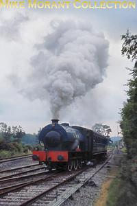 Longmoor Military Railway's Hunslet built austerity 0-6-0ST No. 196 Errol Lonsdale hurries away from Longmoor Downs on 8/6/68.