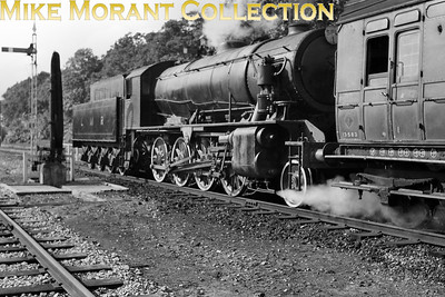 REC: Hants & Surrey Tour 26/9/53 This was the first railtour charted by the Railway Enthusiasts Club at Farnborough and apparently started at North Camp. The motive power for much of the tour was provided by Drummond L12 no. 30434 hauling LSWR pull-push set no. 348. However, having traversed the Bordon branch the tour then proceeded to Longmoor Downs on the military railway behind the LMR's WD 2-8-0 no. 401 Major General McMullen which is depicted here awaiting departure for Bordon. [Mike Morant collection