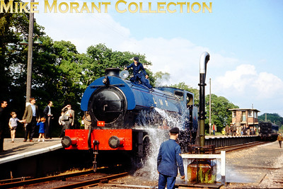 Longmoor Military Railway's Hunslet built austerity 0-6-0ST No. 196 Errol Lonsdale is handily caught on camera whilst taking an unintended shower at Longmoor Downs on 30/4/66.
