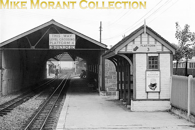 New Romney station on the Romney Hythe & Dymchurch Railway photographed on 30/7/50. A nostalgic picture with the reference to Dunrobin and the contemporary Guinness advert attached to the waiting shelter.