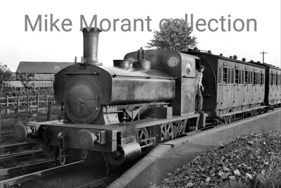 WCMHR  -  Whittingham County Mental Hospital Railway The locomotive is WCMHR #1 an 1888-built Andrew Barclay 0-4-0ST with works no. 304 at work (or possibly posed for the photographer) at what Hugh Madgin believes to be Grimsargh rather than the terminus at Whittingham Hospital near Preston. The only further information I have regarding No. 1 is that she was withdrawn shortly after WW2 to be replaced eventually by the better known ex-LBSCR D1 0-4-2T. For many viewers of this picture (including myself) the carriages are arguably of as much interest as the engine with the one behind the loco's bunker being identified as ex-NLR (North London railway) and Hugh Madgin has since suggested that the barely visible second carriage is of L&Y origin. It's probable that the occasion was one referred to by Henry Casserley whose own image is very similar and that was in 1938.