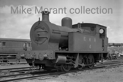 "A Col. Stephens railway negative depicting East Kent Railway 0-6-0T no. 4 posed for the photographer at Shepherdswell on18/7/1936. No. 4 was built in 1917 by Kerr, Stuart and Company (""Victory"" Class, Works No. 3067) for Inland Waterways Docks Dept. of the Royal Engineers and was sold to the EKR in 1919. It was still on the EKR's books at nationalisation but was withdrawn in February 1949 whilst in store at Shepherdswell. [H. C. Casserley / Mike Morant collection]"