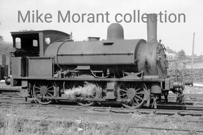 A Colonel Stephens light railway shot taken at Rolvenden in 1946. The loco is Kent & East Sussex Railway Saddleback 0-6-0ST no. 4 which originated with the LSWR as no. 335 of the 330 class. No. 335 was the last of the first batch of six locos of this class built by Beyer Peacock in 1876. It was subsequently numbered 0335 on the LSWR's duplicate list and would survive beyond the 1923 grouping being exchanged ogether with some spares and two ex-LSWR carriages by the Southern Railway for the KESR's 0-8-0T Hecate and three ancient carriages in 1932 where it worked until withdrawal in 1948. [Mke Morant collection]