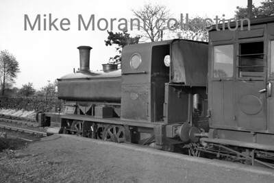 WCMHR  -  Whittingham County Mental Hospital Railway The locomotive is WCMHR #1 an 1888-built Andrew Barclay 0-4-0ST with works no. 304 at work (or possibly posed for the photographer) at what Hugh Madgin believes to be Grimsargh rather than the terminus at Whittingham Hospital near Preston. The only further information I have regarding No. 1 is that she was withdrawn shortly after WW2 to be replaced eventually by the better known ex-LBSCR D1 0-4-2T. For many viewers of this picture (including myself) the carriages are arguably of as much interest as the engine with the one behind the loco's bunker being identified as ex-NLR (North London railway). It's probable that the occasion was one referred to by Henry Casserley whose own image is very similar and that was in 1938.