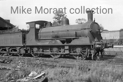 A Colonel Stephens light railway shot taken at Rolvenden in 1946. The loco is Kent & East Sussex Railway former LSWR Adams 0395 class 0-6-0 bearing the number 3440. This engine hadn't been allocated a KESR number because it had been hired from the Southern Railway since December 1941 and was never part of the KESR's own fleet. The KESR was absorbed into BR and 3440 was renumbered to 30576 in March 1948 during a works visit to Ashford. Withdrawal for 30576 came in December 1950 and, according to my records, that was at Guildford but I have no record of when the transfer occurred if, indeed, it ever actually happened. [Mke Morant collection]