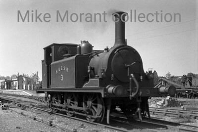 A Colonel Stephens light railway shot taken at Rolvenden prior to WW2. The loco is Kent & East Sussex Railway former LBSCR Stroudley 'Terrier' 0-6-0T no. 3 which originated with the LBSCR as no. 70 being sold to the Rother Valley Railway in 1901. The RVR became the KESR in 1904 and no. 3 remained there until the line's closure in 1954 but was renumbered by BR in September 1949 to become 32670. This celebrity loco was withdrawn by BR in 1963 and is still with us today as a member of, appropriately, the heritage successor to the KESR. [Mke Morant collection]