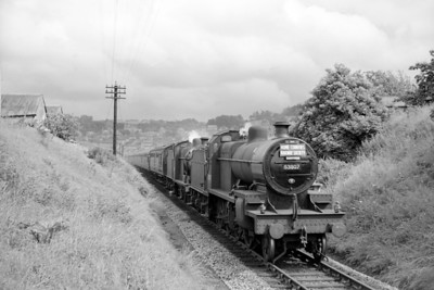 Home Counties Railway Society: Somerset & Dorset Tour 7/6/64. Fowler 7F 2-8-0 no. 53807 pilots 4F 0-6-0 no. 44558 on the final descent towards Bath Green Park..