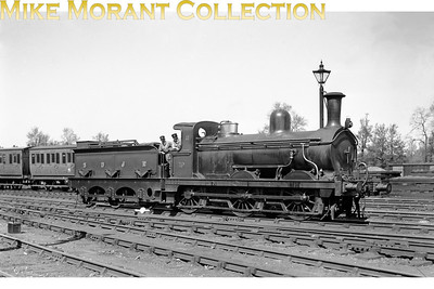 Somerset and Dorset joint Railway no. 19 was an 0-6-0 tender engine built by John Fowler & Co. of Leeds in 1874 and is depicted here in all its finery at Templecombe in 1925. All this class of six engines had working lives of 54 years being withdrawn in 1928.