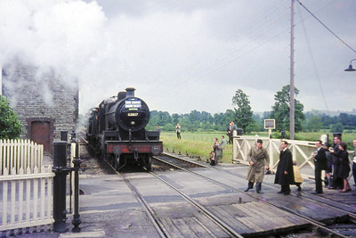 Home Counties Railway Society: Somerset & Dorset Tour 7/6/64. Fowler 7F 2-8-0 no. 53807 and 4F 0-6-0 no. 44558 run round their stock at Evercreech Junction having negotiated the Highbridge branch and will shortly head northwards for Bath.