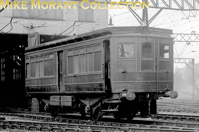 This is the LBSCR's overhead electric depot at Peckham Rye photographed in 1927 but the depicted vehicle, far from being electrically powered, is driven by petrol fed internal combustion engines. This is maintenance vehicle no. 4 Daimler powered with Dick Kerr bodywork and was a conversion from passenger stock. Note that, even this far into Southern ownership, it is still adorned with pre-grouping livery.