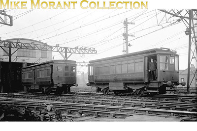 A miniscule copy of this picture appears in David Brown's Southern Electric Volume 1. David has told me that the image in his book was derived from a postcard size print which probably originated with John L. Smith (Len's of Sutton). This version is derived from the original glass negative and benefits from bing a far more detailed original image. This is the LBSCR's overhead electric depot at Peckham Rye photographed in 1927 but the depicted vehicles, far from being electrically powered, are driven by petrol fed internal combustion engines. Both are Daimler powered with Dick Kerr bodywork and according to David's caption no. 1 on the right was purpose built whilst no. 4 was a conversion from passenger stock. Note that, even this far into Southern ownership, both are still adorned with pre-grouping livery.