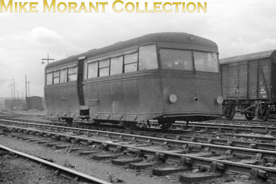 Although the image quality of this negative leaves a great deal to be desired it's one of the most interesting and unsual subjects to enter my collection for quite some time and features one of the three rarely photographed LMSR Leyland diesel powered railbuses dating from 1934. There is a number on one of the side panels but it isn't legible. All three of these vehicles were transferred to Hamilton in Scotland during 1941 and were officially withdrawn from service in 1951 although they hadn't actuall;y been used for two years apparently. I don't know where this shot was taken but it's obviously before the units were dumped at St. Rollox in 1949. It's worth reading Brian Haworth's web page on this subject. THE LINK PAGE OPENS IN A NEW WINDOW.