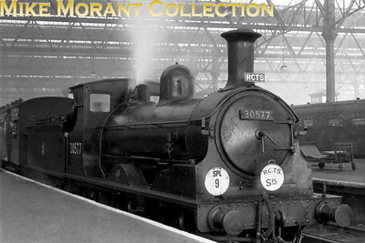 RCTS: Bisley Tramway & North West Surrey Rail Tour 23/11/52 LSWR Adams 0395 class 0-6-0 No. 30577 at Waterloo station. 30577 was built in 1883 and was allocated to Guildford when this tour took place. Withdrawal came in November 1961 from the same shed.