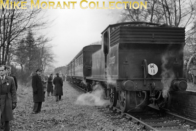 RCTS: Bisley Tramway & North West Surrey Rail Tour 23/11/52 LSWR Drummond M7 class 0-4-4T No. 30027 at Bisley Camp station. 30027  was allocated to Guildford when this tour took place. Withdrawal came in November 1959 at Exmouth Junction shed. Bisley camp station, opened in 1890, had closed to passenger traffic on July 21st some four months before this shot was taken. [Mike Morant collection]