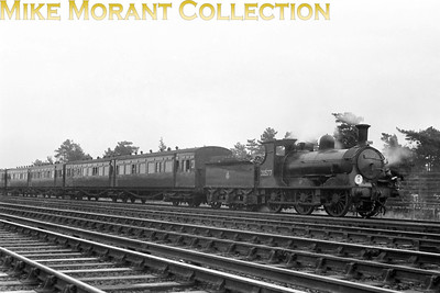 RCTS: Bisley Tramway & North West Surrey Rail Tour 23/11/52 LSWR Adams 0395 class 0-6-0 No. 30577 at Brookwood. Note the Sheppey articulated stock which was used twice for the Bisley legs of the tour in order to accommodate all the tour participants. 30577 was built in 1883 and was allocated to Guildford when this tour took place. Withdrawal came in November 1961 from the same shed.