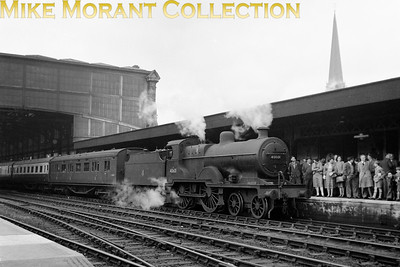 Ian Allan: Somerset & Dorset Special 25/4/54. Fowler 2P class 4-4-0 no. 40601 waits at Bournemouth Central station, together with a considerable human presence, for Maunsell 'Schools' class 4-4-0 no. 30932 Blundells to arrive from servicing and be attached as the pilot engine for the arduous climb over the Menjdips to Bath Green Park. 30932 had brought this special from Waterloo and would later be the motive power for the return to London from Templecombe. Note that the first vehicle in the train is a SECOND class brake saloon normally used for boat trains where three classes of travel remained available until the erstwhile third class universally became second in June 1956. [Mike Morant collection]