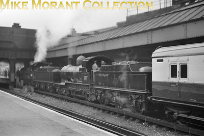 RCTS: Swindon & Highworth Railtour 25/4/54 Collett 'Dukedog' 4-4-0's, 9011 nearest the camera and 9023 leading, on the SE side of Victoria station. [Mike Morant collection]