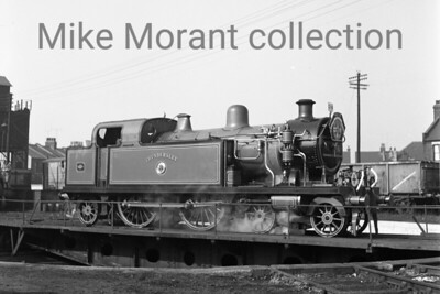 RCTS: Southend Centenary Special 11/3/56 The featured loco on the turntable at Shoeburyness mpd is the newly restored LTSR class 79 4-4-2T No. 80 Thundersley. No. 80 was a Whitelegg designed engine built by Robert Stephenson & Co.  that entered service for the London Tilbury and Southend Railway in 1909 but would lose its name and number in 1912 when that railway was absorbed by the Midland Railway.  The latter classified the class as 3P and No. 80 became 2177 under the Midland's regime. Further renumbering took place in 1930 under auspices of the LMSR and so No. 80/2177 became 2148. Absorption into BR stock at nationalisation saw the number 41966 being applied which this loco carried until withdrawal from service at Toton shed in 1956. This was Thundersley's second and last public outing in its preserved state  - there had been a BR sponsored single journey from Southernd to Liverpool St.on Saturday, March 3rd - but the loco has survived to this day in the collection housed at Bressingham. [Mike Morant collection]