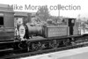 <center><b>Caterham Railway Company: Caterham Centenarian 6/8/56</b><br> This very short trip saw the Brighton Works shunter, Stroudley Terrier 377S, journey from Purley to Caterham and back in the company of red liveried SECR birdcage set no. 580. Here we see the Terrier at Purley station having returned from Caterham.<br> [<i>Mike Morant collection</i>]</center>