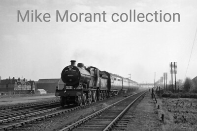 """RCTS East Midlander No. 2 Rail Tour 6/5/56 This tour used Johnson 2P 40454 solo for the first leg of the trip: Nottingham Midland - Castle Donnington - (via Camp Hill) - Bromsgrove - Worcester Shrub Hill - Norton Jn - Cheltenham Spa Lansdown and possibly for the last leg: Swindon Works - Oxford - Bletchley - Blisworth - Northampton Bridge Street - Wellingborough - Kettering - Nottingham Midland. But does anyone recognise this location?It seems that Tony Walmsley's efforts to nail this location down have borne fruit:  """"It looks like the approach to Beeston (Notts).  The clue is the half timbered building on the left.  Looking at Google Earth, I notice that a very similar shaped buidling exists today on Grace Avenue at its corner with Windsor Street.  It is now rendered, but the roof line looks almost the same and there are even simlar industrial buildings opposite.  That makes the bridge in the background the main entrance road into Boots.  The train would therefore be travelling South West, putting the sun in the South East which would fit with a morning start from Nottingham.  There were goods loops at this location and on the left would be part of Beeston goods yard.""""Vic Smith adds: """"Have checked with a 1956 map which clearly shows Nos 10-17 Grace Avenue, allotments, track into yard, Windsor Works Iron Foundry, signal positions and bridge whilst the building to right is on Lilac Crescent. According to the map the train is passing milepost 123½. """"And from Syd Hancock: """"The comments which you already have are correct - I should know I worked in this area for 47 years and saw this view every working day. The train is approaching the station which is 50- 60 yards behind the photographer. The track in the foreground is the up goods loop which ended immediately behind the photographer. The bridge in the background is indeed that which gives access to the Boots factory site."""""""