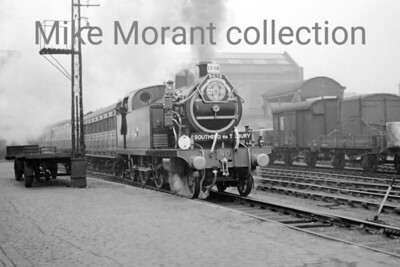 RCTS: Southend Centenary Special 11/3/56 The featured loco is the newly restored LTSR class 79 4-4-2T No. 80 Thundersley departs from Bishopsgate Goods and travelled via Stratford, Forest Gate Junction, Barking and thence on former LTSR metals to Shoeburyness whilst the return Journey terminated at Fenchurch Street station. No. 80 was a Whitelegg designed engine built by Robert Stephenson & Co.  that entered service for the London Tilbury and Southend Railway in 1909 but would lose its name and number in 1912 when that railway was absorbed by the Midland Railway.  The latter classified the class as 3P and No. 80 became 2177 under the Midland's regime. Further renumbering took place in 1930 under auspices of the LMSR and so No. 80/2177 became 2148. Absorption into BR stock at nationalisation saw the number 41966 being applied which this loco carried until withdrawal from service at Toton shed in 1956. This was Thundersley's second and last public outing in its preserved state  - there had been a BR sponsored single journey from Southernd to Liverpool St.on Saturday, March 3rd - but the loco has survived to this day in the collection housed at Bressingham. [Mike Morant collection]