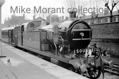 British Railways: Southend Centenary Special 3/3/56 The featured loco is the newly restored LTSR class 79 4-4-2T no. 80 Thundersley on display at the south side of Southend Central station prior to working the special. No. 80 was a Whitelegg designed engine built by Robert Stephenson & Co.  that entered service for the London Tilbury and Southend Railway in 1909 but would lose its name and number in 1912 when that railway was absorbed by the Midland Railway.  The latter classified the class as 3P and No. 80 became 2177 under the Midland's regime. Further renumbering took place in 1930 under auspices of the LMSR and so No. 80/2177 became 2148. Absorption into BR stock at nationalisation saw the number 41966 being applied which this loco carried until withdrawal from service at Toton shed in 1956. Thundersley has survived to this day in the collection housed at Bressingham. [Mike Morant]