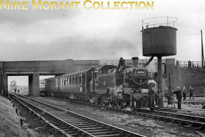 """S.L.S. (Midland Area) Nottinghamshire Coalfield Rail Tour 27/4/57 Standard 2MT 2-6-2T 84006 at Bilsthorpe on 27/4/57.Nothing like local and specialised knowledge which, this time, is a welcome contribution from Richard Maund: """"The train  is standing in the MNJ (Mid-Nottinghamshire Joint) loop, facing towards Ollerton with the tail of the train under Bridge no. 22 Bilsthorpe Road (which has been dropped  since closure) grid ref SK 651605. Bilsthorpe (MNJ) box is visible  through the left hand arch. The pic brings out nicely the fact that the bridge comprised two elements: steel parapets for the LNE side and brick for the (later) MNJ side."""""""