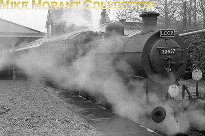 LCGB Southern Counties Limited 24/2/57 This tour had a most unusual itinerary starting from London's Marylebone station behind ex-GCR motive power whilst later including the Blubell line and the Hayling Island branch. Here we see Billinton/Marsh C2X class 0-6-0 No. 32437 at a cold, wet and windy Horsted Keynes on the Bluebell lineAwaiting departure for the legs to Brighton and Preston Park.