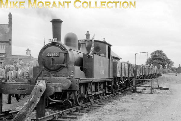 <b>RCTS: Yorkshire Coast Rail Tour 23/6/57</b><br> Worsdell J71 class 0-6-0T no. 68246 of 1889 vintage played a small but significant role during this tour being the motive power for a rake of open wagons plus brake van that traversed the short Easingwold Light Railway's metals from Alne and back and easingwold is where this picture was taken. 68246 spent its entire working life based at York and would be withdrawn in November 1958 after 69 years of service.<br> [<i>Mike Morant collection</i>]