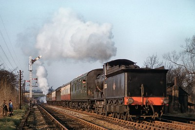 G.R. Lockie: The Portsmouth Direct Line Centenarian 25/1/59 LSWR Drummond 700 class 0-6-0 no. 30350 is already on the Gosport branch as she departs from Fareham with Maunsell 'Q' class 0-6-0 no. 30567 bringing up the rear. Note the two Pullman cars in the rake of stock the nearer of which is in plain green livery. [Mike Morant collection]