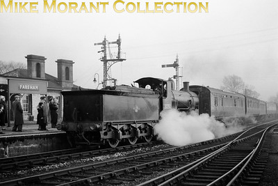 G.R. Lockie: The Portsmouth Direct Line Centenarian 25/1/59 LSWR Urie 700 class 0-6-0 no. 30350 at Fareham. Note the Pullman car in the rake of stock. [Mike Morant collection]