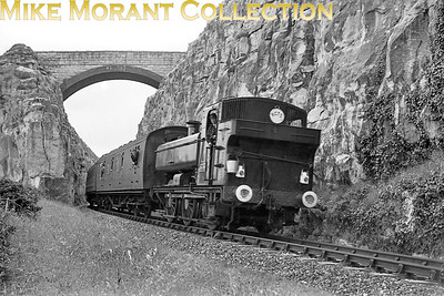 RCTS: The Greyhound 14/8/60 Weymouth allocated, Collett 5700 class 0-6-0PT no. 3737 is shown here between Portland and Easton. The magnificent bridge and the Portland stone cliff face are worthy of note. [Mike Morant collection]
