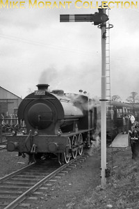 LCGB: The Six Counties Limited 3/4/60. Austerity 0-6-0ST WD 132 at Arncott on the Bicester Military Railway. [Mike Morant collection]