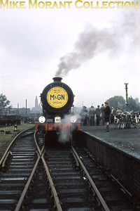 M&GNRPS: M&GN and Waveney Valley Rail Tour 8/10/60 GER/LNER, Gresley/ Holden B12 4-6-0 no. 61572 awaiting departure from the careworn Norwich City station which had closed in March the previous year. 61572 would survive into the heritage era and is till active as I write this in May 2013.