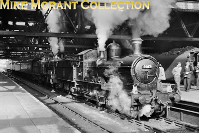 Talyllyn Railway Preservation Society: A.G.M. Special 24/9/60 The participants were transported from Paddington behind Churchward 2-8-0 no. 4701 as far as Shrewsbury where Dukedog 4-4-0 no. 9017 and Churchward mogul no. 7330 took over haulage duties to Towyn. Here we see that double-header ready to depart from Shrewsbury station. [Mike Morant collection]