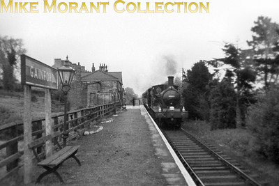 RCTS and Stockton & Darlington Locomotive Society: J21 Rail Tour 7/5/60. Ex-NER Worsdell J21 class 0-6-0 no. 65033 passes through the rarely photographed Gainford station between Barnard Castle and Darlington. Gainford station would close on 30/11/1964. 65033 managed to survive into the heritage era and is currently (2019) at Loughborough awaiting restoration. [Mike Morant collection]