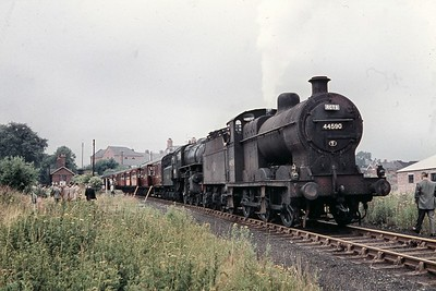 RCTS: Dukeries Rail Tour 24/7/60. The early part of this quite lengthy tour was double-headed by Fowler 4F no. 44590 and Ivatt 'Flying Pig' 2-6-0 no. 43145 as shown here during a short photostop at the erstwhile Clowne & Barlborough station which had closed to passenger traffic some six years previously. The 4F would be detached at the next station, Elmton & Cresswell leaving 43145 to manage the journey onwards to Lincoln and the return, unaided, to Sheffield Victoria. [Mike Morant collection]