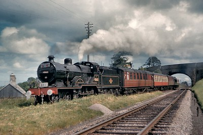 SLS/RCTS: Scottish Rail Tour 14/6/60 Fowler 2P class 4-4-0 no. 40663 was incharge of this tour from Elgin to Burgheas, Forres and Inverness and is depicted here at Alves Jct. on the way to Burghead which had seen no passenger traffic since 1931. 40663 might appear to out of place at this location but she was allocated to Kittybrewster shed from 1954 until 1961. [T. B. Owen / Mike Morant collection]