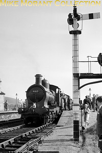 Talyllyn Railway Preservation Society: A.G.M. Special 24/9/60 The participants were transported from Paddington behind Churchward 2-8-0 no. 4701 as far as Shrewsbury where Dukedog 4-4-0 no. 9017 and Churchward mogul no. 7330 took over haulage duties to Towyn where this shot was taken. [Mike Morant collection]