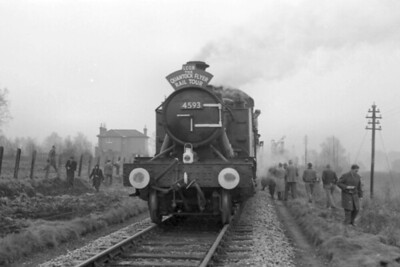 LCGB: The Quantock Flyer 16/2/64. Collett 4575 class 2-6-2T no. 4593 is shown here during a 47 mins photo stop at Montacute on the line from Yeovil Town to Langport which would close in its entirety on the following June 15th. [C. L. Caddy / Mike Morant collection]