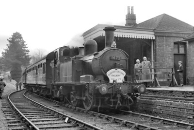 GRS: Cirencester Town and Tetbury Branches Last Steam Train 5/4/64. The final day of passenger operations on the Cirencester (GW) and tetbury branches was marked by this tour which was organised by the Gloucestershire Railway Society.and originated at Gloucester. Here we see the sole motive power on the day in the form of Horton Road allocated Collett 1400 class 0-4-2T no. 1472 standing at Tetbury station. [Mike Morant collection]