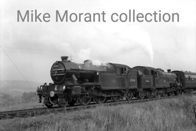 RCTS: The North Yorkshireman Rail Tour 25/4/64 According to the sixbellsjunction web site this tour was beset with problems that led to very late running. Some of this was allegedly attributable to steady Yorkshire rain which is apparent in this slightly out of focus shot of the unusual pairing of LNER Gresley V1 2-6-2T no. 67646, a Gateshead engine, and Stanier 4MT 2-6-4T no. 42639, a Darlington engine but for not much longer taken at Middleton-in-Teesdale.
